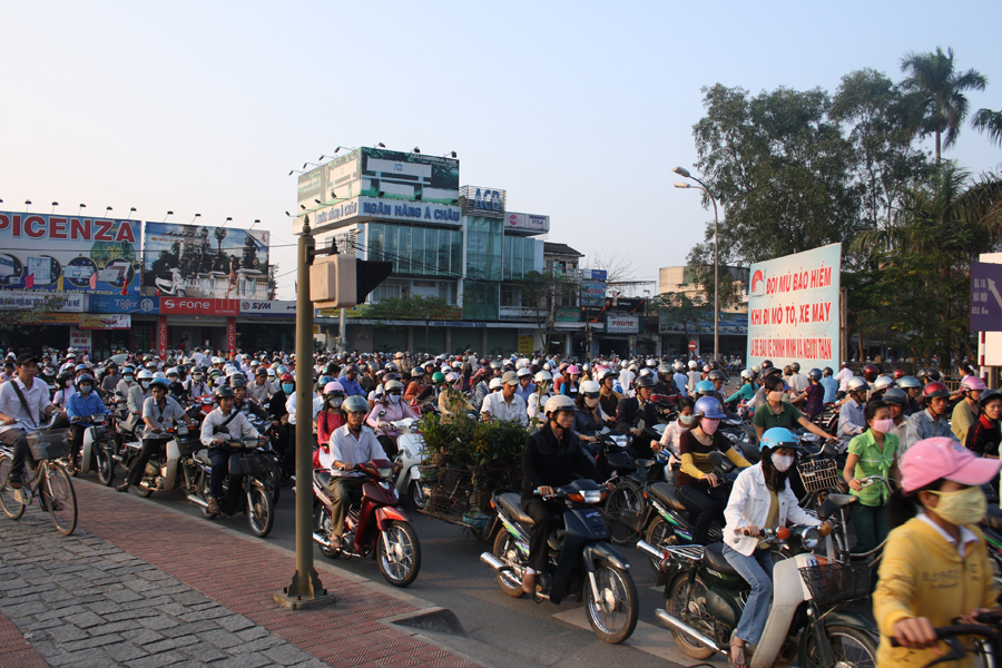 Photo of a street in Vietnam filled with motorcycle traffic.