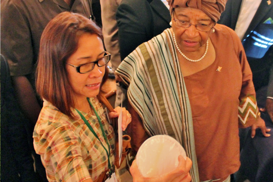 Photograph of Liberian President Ellen Johnson Sirleaf, with Liberia FED Chief of Party Agnes Luz