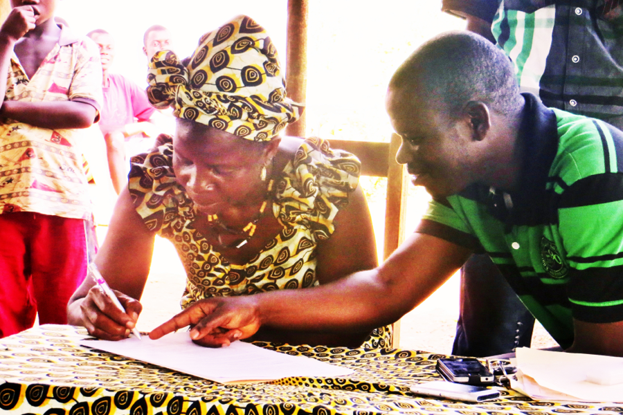 Photo of a contract signing for an agricultural loan