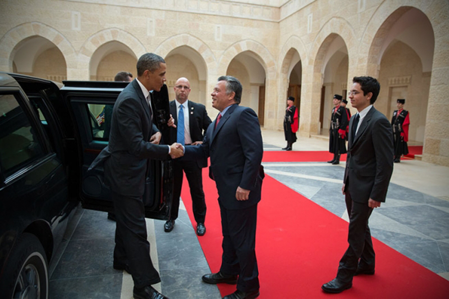 Photo of President Barack Obama being greeted by King Abdullah II of Jordan.