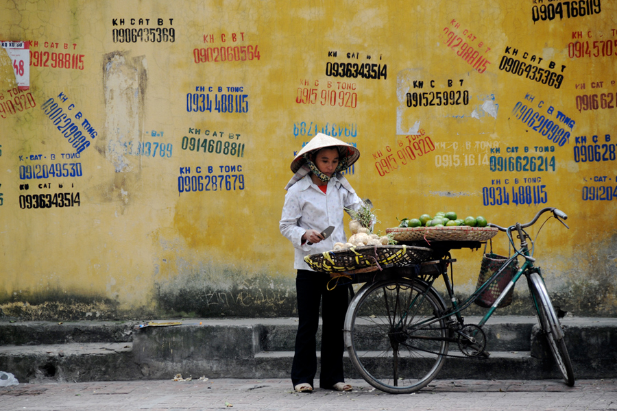 Photo of a woman street vendor in Hanoi, Vietnam.