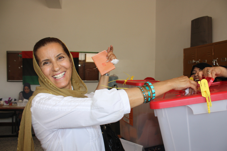 Photo of a Libyan woman voting during the General National Congress Elections.