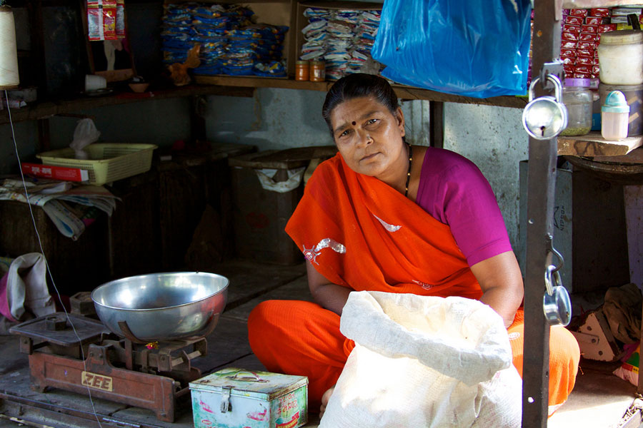 Photo of a woman running a local market.
